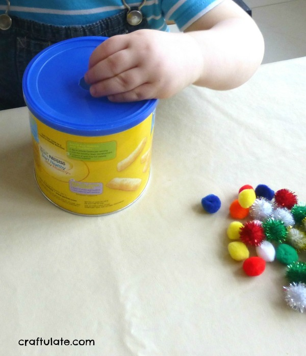 Pom Pom Drop for fine motor practice for toddlers