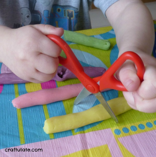 Learning To Use Scissors - an essential fine motor skill for little kids