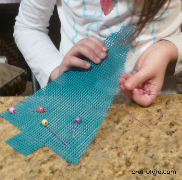 Fine Motor Christmas Tree Sewing Activity from Craftulate