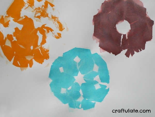 Tissue Paper Snowflake Art - a fun winter activity for kids!