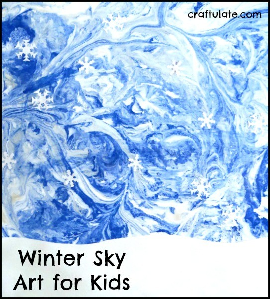 Winter Sky Art for Kids - using a marbling technique and paper punch snowflakes!