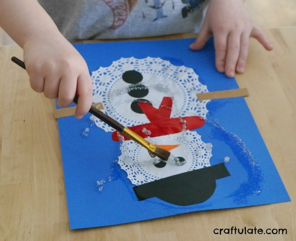 Doily Snowmen Craft - a fun winter activity for kids