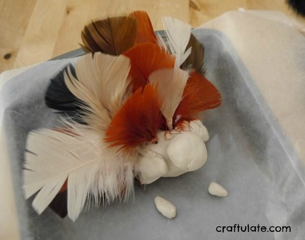Clay Turkey Craft for Kids - use air dry clay, feathers and paint to make this cute turkey!